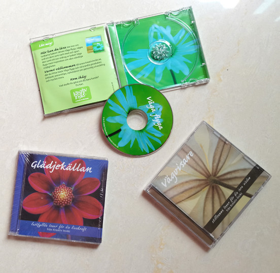 7.5mm Mini 1-CD In Case Clear Packaging With 4 Pages Booklet Insert And One Page Tray Card