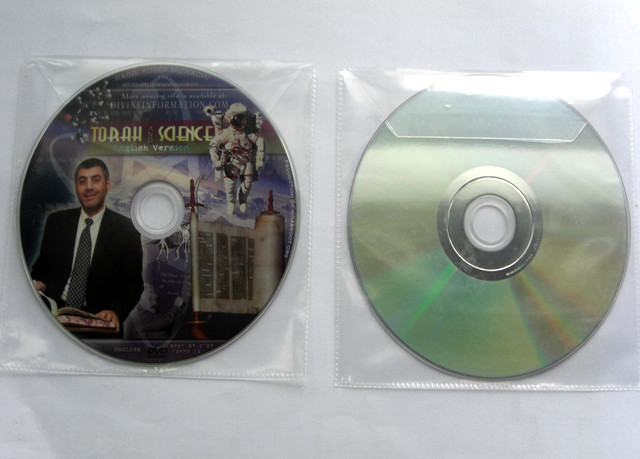 CD DVD in plastic sleeve with adhesive tape packaging