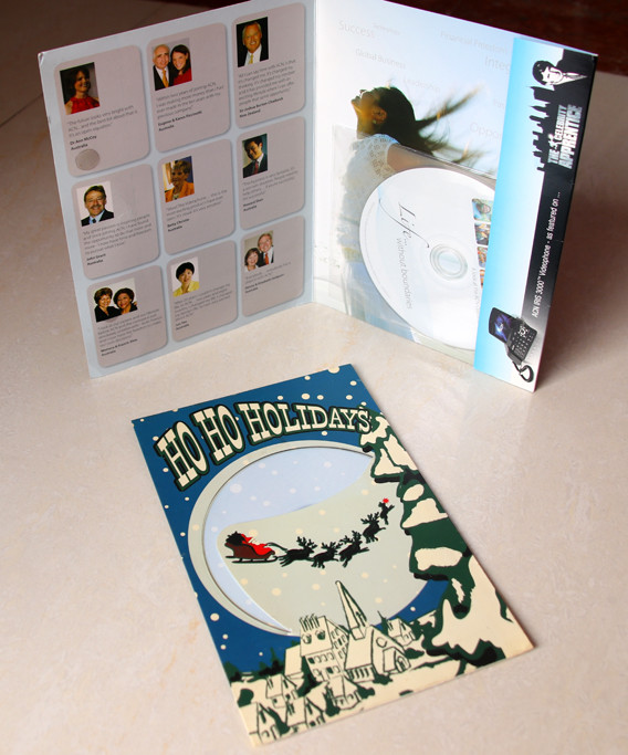 dvd in plastic sleeve then stick on cardboard gift packaging