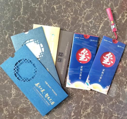Pendants gift invitation card design in cardboard envelope